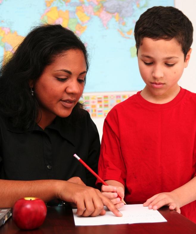 teacher tutoring student