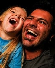 father and child laughing